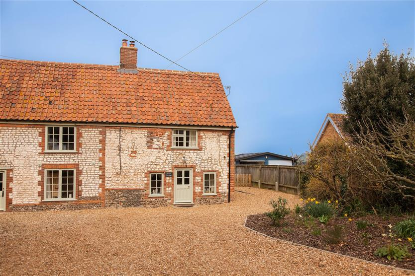 Click here for more about Sutton Cottage